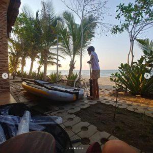 Kid assembling an inflatable sailboat tiwal 3 in Angola