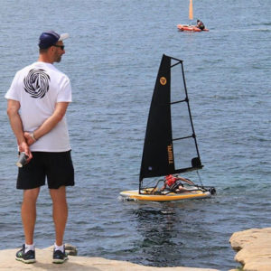 Man looking at Tiwal 3 inflatable sailboat in New Zealand