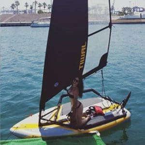 Woman sailing the Tiwal 3 inflatable sailboat in Spain