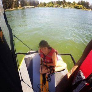 Teenager sailing inflatable sailboat tiwal 3