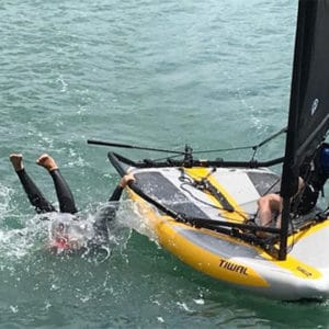 Kid falls into the water from his Tiwal 3 sailboat