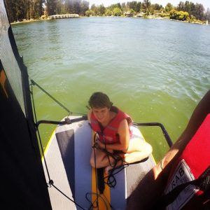 Teenager sailing inflatable sailboat tiwal 3