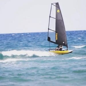 Tiwal 3 inflatable sailboat surfing in waves