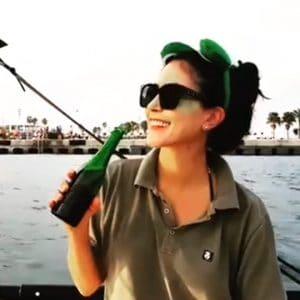 Woman enjoying sailing a Tiwal 3 inflatable sailing dinghy