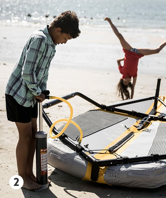 Inflating Tiwal sailing dinghy with the manual high pressure pump
