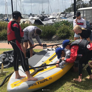 Kids assembling Tiwal 3 inflatable sailing boat in New Zealand