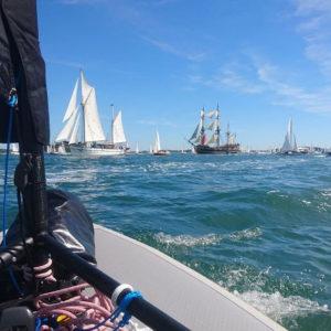 Pocket Sailboat Among Old Rigging Boats
