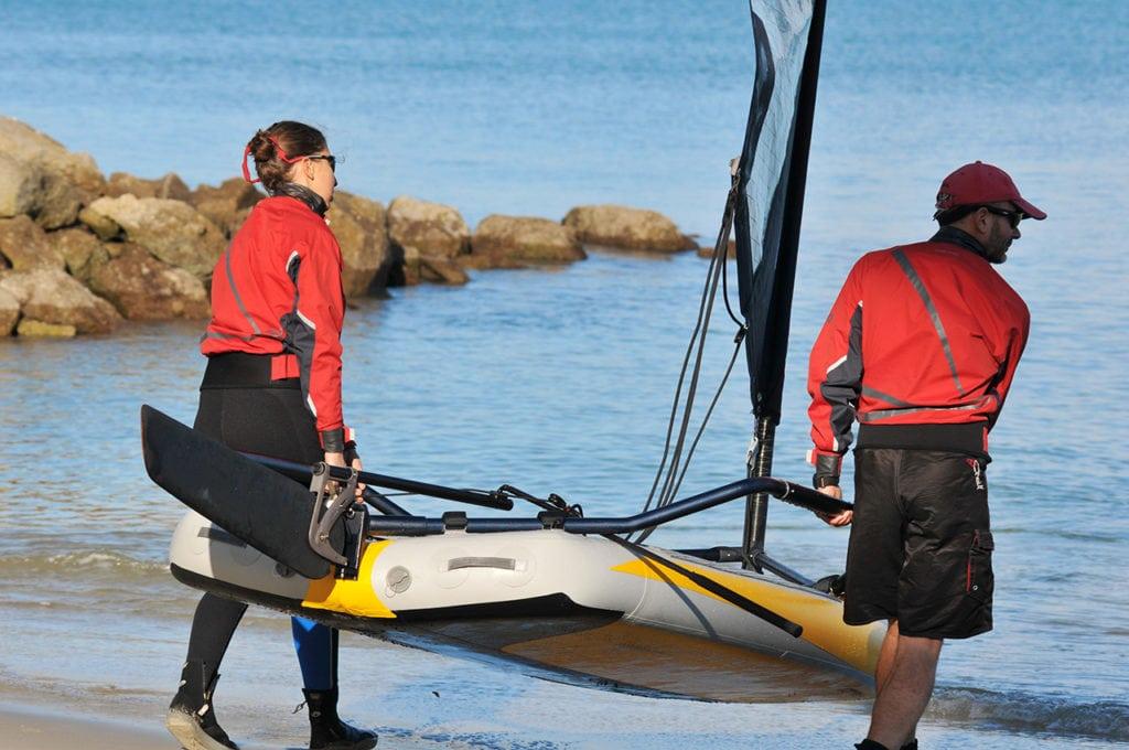 Bringing Tiwal Sailboat close to the water